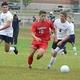 Senior forward Matt Lemos (10) is on the attack against Dracut.