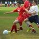 Tewksbury's Benn LaFortune (9) holds off a Dracut defender.