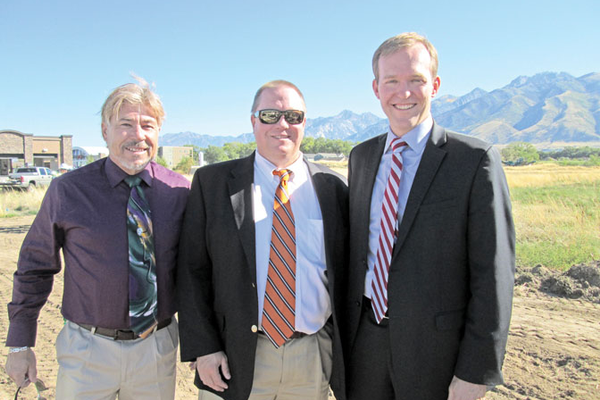 City Councilmember Bill Rappleye, Mayor Troy Walker and Salt Lake County Mayor Ben McAdams celebrate the Wheadon Farm Park groundbreaking.