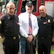 MB Fire Department Battalion Chiefs Frank Chiella and Ron Laursen flank MB resident and veteran George Butts.