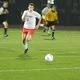 Junior forward Nick McKeon (1) chases down a through ball.