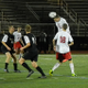 Junior midfielder John Donovan (22) goes up for a header.