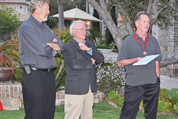 Kent Campbell, right, addresses the crowd at a celebration of his 30th anniversary working at the club. He is shown with long-time Boys & Girls Club supporters, Dave Peter and Bob Adams.