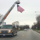 Oswego firefighters welcomed Carter home with the display of a large U.S. Flag flying over Route 34.