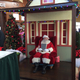 Santa waits in his house for picture-takers