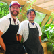 Chefs Andy Barnes and Andy Ziegler tend to the greenhouse  Photo by Jennie Lay