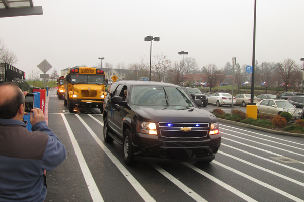 A full police escort accompanied the two bus loads of students.