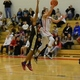 Alex DiRocco (3) drives in for two of his 17 points.