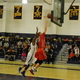 Justin Derrah (42) goes up for two of his caeer-high 23 points against Malden.