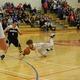 Nate Tenaglia (4) sprawls for a loose ball against Wilmington