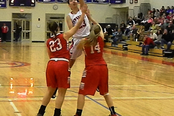 Molly Robertson (23) fights for a rebound against Melrose.