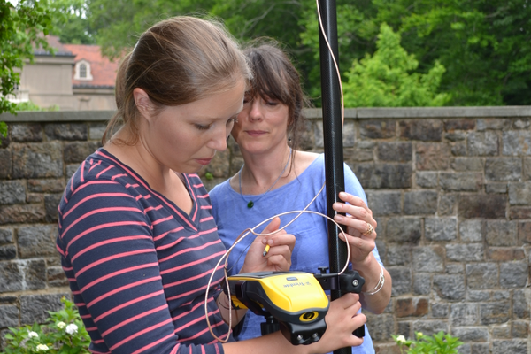 Winterthur horticulturalist Lori Schnick teaches intern Hayden King the basics of mapping.