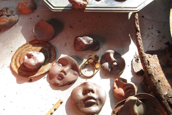 Creshkoff makes faces out of local clay to be used in her rusty angel sculptures.