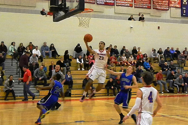 Adam Gajjaoui (23) drives for two against Bedford.