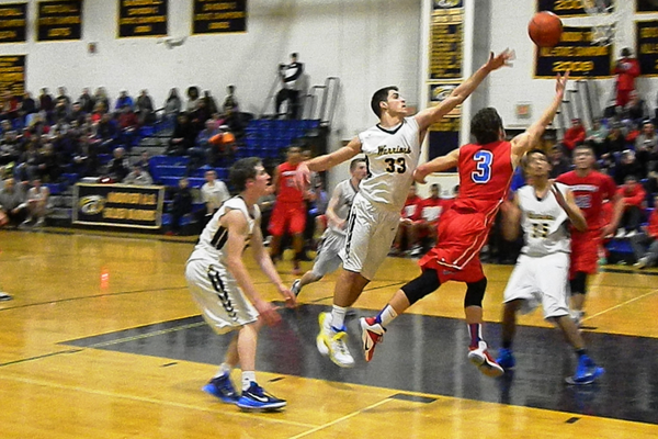 Alex DiRocco (23) drives the lane for two of his game-high 26 against Andover.
