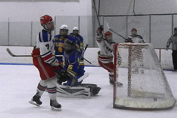 Derek Castiglione (7) scored his first goal of the season against Acton-Boxboro.