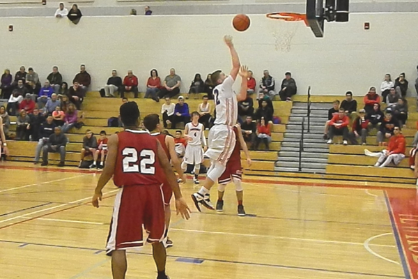 Justin Derrah (42) goes up for two of his team-high 21 points against Lowell.