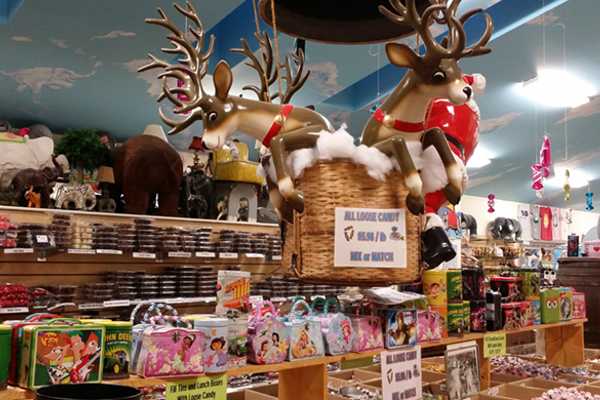 Santa and his reindeer watch over the more than 700 varieties of candy at Mister Ed's.