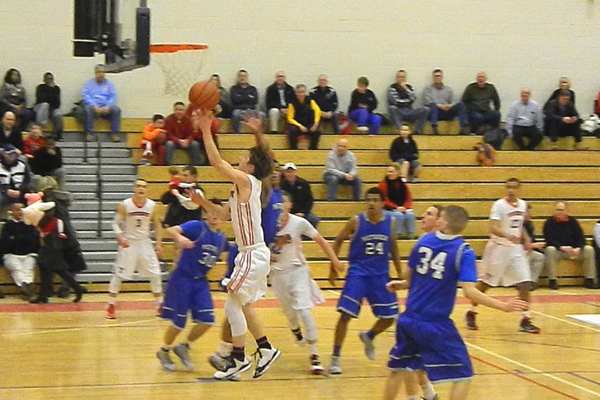 Nate Tenaglia (4) drives in for two of his 22 points against Methuen.