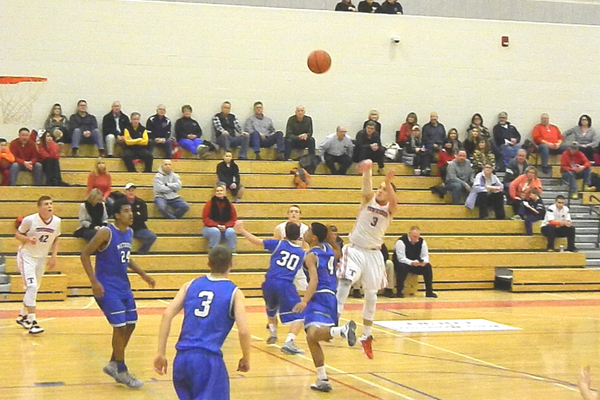 Senior guard Alex DiRocco (3) tosses one up from the foul line.