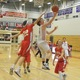 Nate Tenaglia (4) drives the lane for a reverse lay-up.