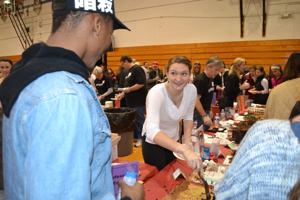 Unionville High School student Samantha Pancoast entices a chocolate lover to try a sample.