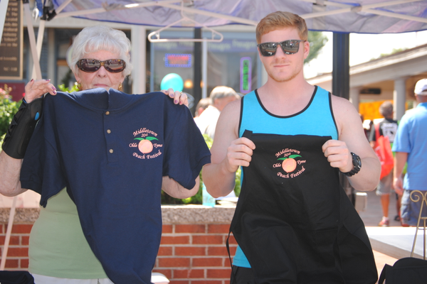 The official t-shirts of the 20th annual Olde Tyme Peach Festival.