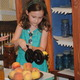 Stacy Browning tries out the peach peeler that is included as part of the peach exhibit.