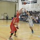 Henry Roberts (21) fires off a three-pointer.