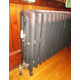 The cast-iron radiators were probably original to the building.