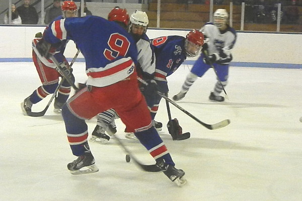 Senior forward Patrick Leonard (9) rips a shot at the Methuen net.