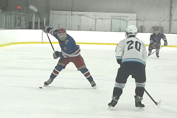 Senior forward Ryan Petti (8) unleashes a slap shot from the point.