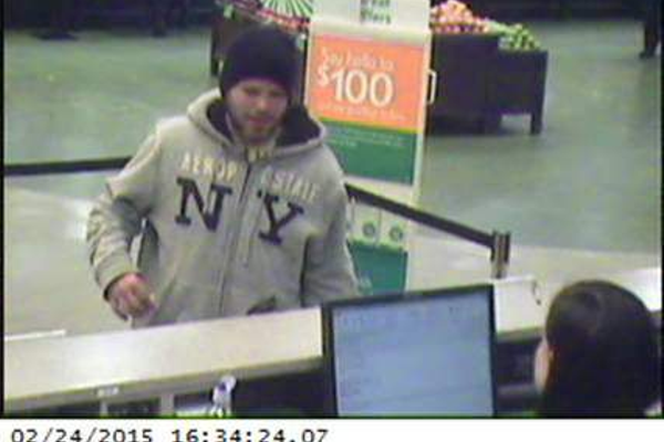 Law enforcement officials believe this still image shows Seamus Murphy  robbing the Citizens Bank in the Shaw's Supermarket, Stratham, NH