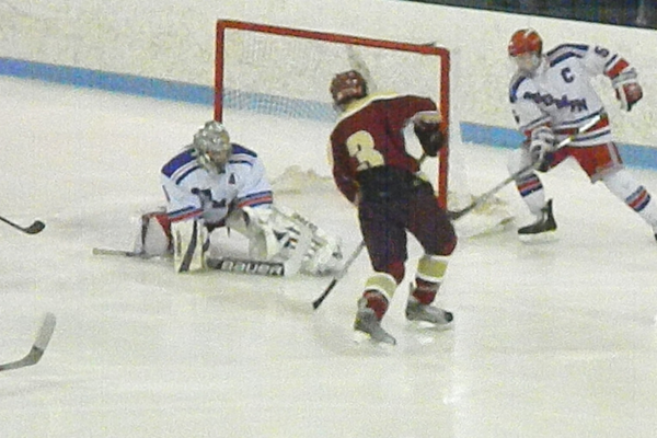 Kyle Paquette makes the save in the Tewksbury net.