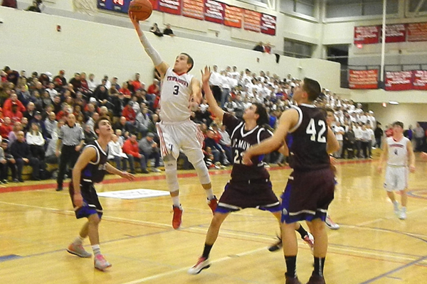 Alex DiRocco (3) scored 18 points to lead Tewksbury to a 58-56 win over Belmont.