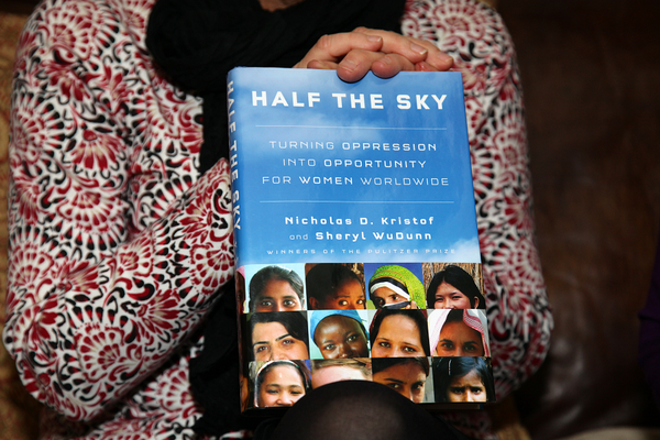 Penny Estes holding a copy of Half the Sky