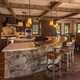 Stonework and thick wood beams give he kitchen an earthy feel  Photo by Tim Murphy