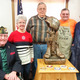 "Orville Sette, John Schmid, and Terry Appenfeldt from the Senior Center Woodshop built a wooden stand to support the ""Statue of the Fallen Hero"" that Don Laabs recently donated to the Beaver Dam Senior Center. The stand includes medallions from all branches of the United States military."