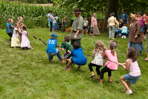Every year children line up to participate in the yard games at Rural Heritage Day!  Tug-o-war is a perennial favorite.  Check the Event Map for game times.   Directions:  Turn west in Lewisburg from Route 15 onto Route 192 and drive 1 ½ miles.  Turn North on Strawbridge Road and go another 1 ½ miles to the Dale/Engle/Walker property.  Watch for signs pointing to the Rural Heritage Day NEW ENTRY onto the property.  This new entry will take you on a farm lane to the parking area.  The ample parking area will be indicated and staffed.    Visitors will walk down the farm lane which leads to the homestead and all the Rural Heritage demonstrations and events.     Photo by Jim Walter.