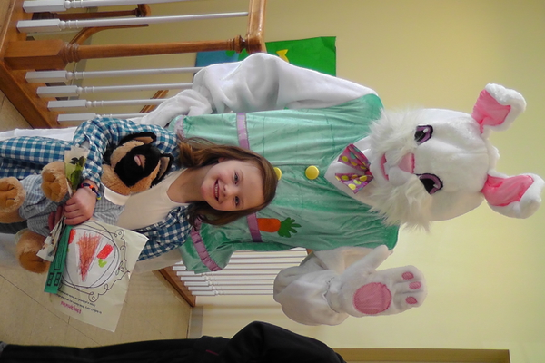 The Easter Bunny greeted excited youth (Lydia Barnes) on his way to his seat of honor.