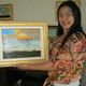 Hong with one of her small landscapes.