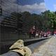 Tom's fatigue hat sits on the Vietnam Veterans Memorial Wall in D.C.