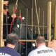 Bellingham firefighters watch a rescue involving a mannequin's arm being separated from a fence.