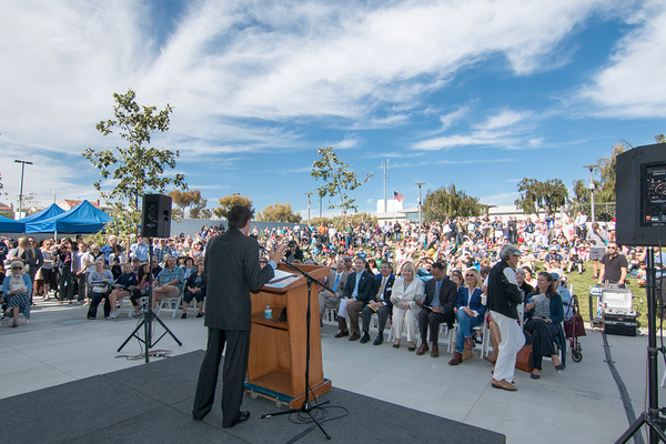 Manhattan Beach Mayor Wayne Powell addresses the crowd on a beautiful sunny afternoon in Manhattan Beach. An excited public gathered outside the new Manhattan Beach Public Library awaiting its opening on Friday, May 1, 2015. Photo by Brad Jacobson.