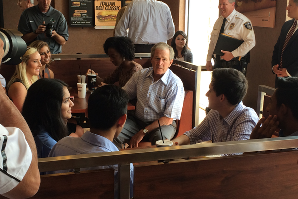Senior leadership on the team meets with President George W. Bush. Photo courtesy of Jason Sykes.