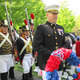 1812 Constitution Marines escort parade Grand Marshal and Keynote Speaker to place wreaths at the Memorial