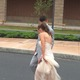 Prom-goers make their way to the limos.