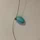 Thread a starter bead on one end of your wire