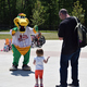 Lowell Spinners Canaligator dancing with Mr. Toohey and daughter Oliva