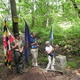 Citizens of Maryland Pennsylvania and Delaware stand with their state flags at the Tri-State Marker for the dedication ceremony